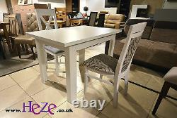 Extending dining table in light oak, dark oak and white colours, perfect size