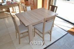 Extending dining table in oak sonoma, strong, high quality best on eBay