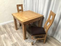 Oak Furniture Land Solid Oak Extendable Dining Table And 2 Solid Oak Chairs