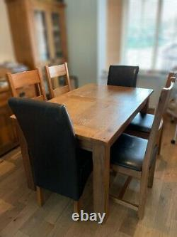 Solid oak rustic 4ft7 x 3ft extending dining table and 6 oak chairs
