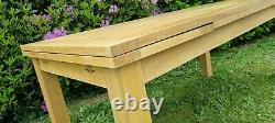 Used solid oak extending dining table