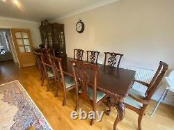 Used solid oak extending dining table and chairs